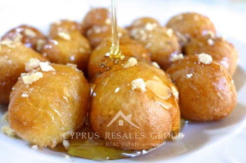 Loukoumades are sweet little balls of dough drizzled with honey and then sprinkled with cinnamon.