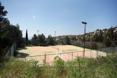 Enjoy some tennis on the full sized tennis courts in the luxury Leptos Kamares Village, Tala Cyprus.