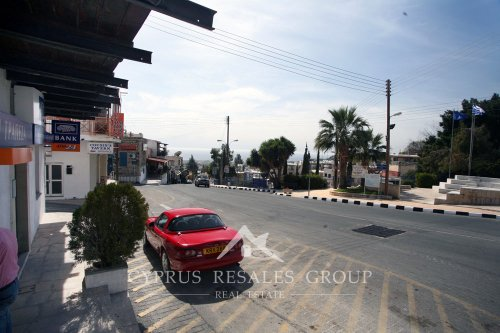 Banks and cafes on the central street in Peyia, Cyprus